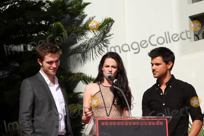 Kristen Stewart,Robert Pattinson,Taylor Lautner Photo - Handprint and Footprint Ceremony for the Twilight Saga Actors Pattinson Stewart and Lautner