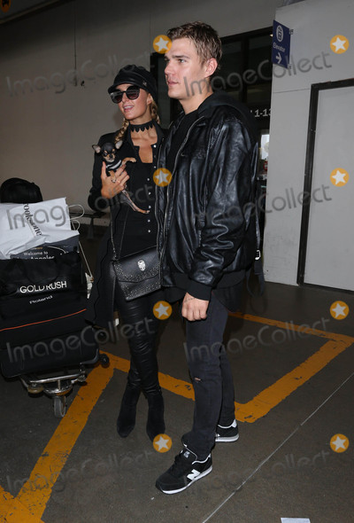Photos From Paris Hilton and her new boyfriend are seen at LAX Airport