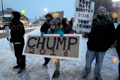 Photo - Photo by Dennis Van TinestarmaxinccomSTAR MAX2016ALL RIGHTS RESERVEDTelephoneFax (212) 995-11962816Donald Trump protestors in Manchester New Hampshire