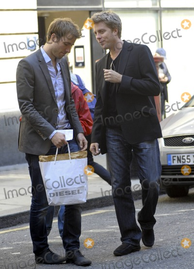 Kyle Eastwood Photo - Clint Eastwoods son Kyle Eastwood chats with a friend outside BBC Radio 2 London UK 41911