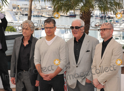 Photo - Matt Damon  Michael Douglas with director Steven Soderbergh  producer Jerry Weintraub at photocall for their movie Behind the Candelabra at the 66th Festival de CannesMay 21 2013  Cannes FrancePicture Paul Smith  Featureflash