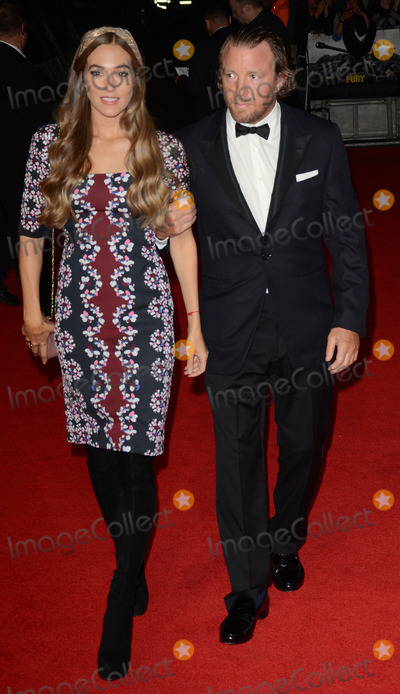 GUY RICHIE Photo - London UK Jacqui Ainsley and Guy Richie at the  2014 BFI LFF Closing Gala Screening of Fury  on Sunday 19th October 2014  Ref LMK392-49852-201014Vivienne VincentLandmark Media WWWLMKMEDIACOM David Ayer and Guest