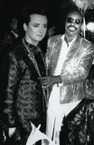 Boy George Photo - Boy George with Stevie Wonderduring the taping of the television special Motown Returns to the Apollo Harlem New York May 4 1985Credit McBrideface to face