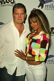 Carlos Santana Photo - John Edward Yarbrough and Traci Bingham at the Deborah and Carlos Santana Milagro Foundation Benefit on the rooftop of the Hyatt On Sunset West Hollywood CA 08-31-04