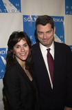 Jami Gertz Photo - Jamie Gertz and husband at the Cool Comedy - Hot Cusine gala benefiting the Scleroderma Research Foundation Regent Beverly Wilshire Beverly Hills CA 11-01-02