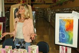 Olivia Newton-John Photo - Olivia Newton-John at the sale of the Official Breast Cancer Awareness Postage Stamp  Breast Self-Exam Liv Kit at the Burbank Savon Burbank CA 10-07-04