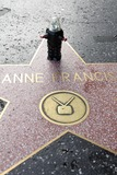 Anne Francis Photo - Anne Francis Star with a small Robby The Robot placed there by a fan to commemorate her passing today Hollywood Walk of Fame Hollywood CA 01-03-2011