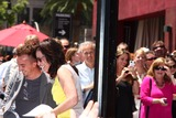 Frankie Muniz Photo - LOS ANGELES - JUL 16  Frankie Muniz Jane Kaczmarek at the Hollywood Walk of Fame Star Ceremony for Bryan Cranston at the Redbury Hotel on July 16 2013 in Los Angeles CA