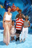 NICOLE MITCHELL Photo - Photo by  Tom LauLoud  Clear MediaSTAR MAX Inc - copyright 2003  ALL RIGHTS RESERVED 51803Nicole Mitchell Murphy  her kids with Eddie Murphy at the World Premiere of Finding Nemo from Pixar Animation StudiosWalt Disney Pictures(CA)