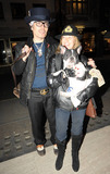 Adam Ant Photo - New wavepunk musician Adam Ant arrives with his dog Elvis and a friend at Keith Richards Life book signing in the West End of London UK 11310
