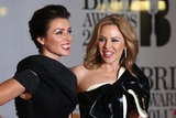 Dannii Minogue Photo - Kylie Minogue Dannii Minogue arriving at The Brit Awards (Brits) 2014 held at the O2 London 19022019 Picture by Henry Harris  Featureflash