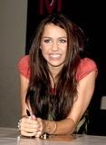 Hannah Montana Photo - London UK Miley Cyrus star of Disney Channels smash hit Hannah Montana makes a personal appearance to greet fans and sign copies of the Hannah Montana Behind the Spotlight DVD at HMVs Oxford Street store 27th March 2007Ali KadinskyLandmark Media