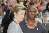 Chris Eubanks Photo - London UK Chris Eubank  and wife Karron  at the European Premiere of Public Enemies at the Empire Leicester Square Central London        29 June 2009Ali KadinskyLandmark Media