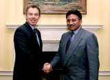 Pervez Musharraf Photo - ALPHA M045804 08112001Prime Minister Tony Blair (L) greets Pakistans President General Pervez Musharraf as he arives at 10 Downing Street in central LondonMusharraf today warned that current outside efforts to help the anti-Taliban opposition in Afghanistan risk failure because they focus only on the ethnic minority Northern AllianceCREDIT ALPHAGLOBE PHOTOS INC