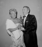 Lana Turner Photo - Lana Turner with Red Buttons at the Oscar Awards 1958 Supplied by Globe Photos Inc