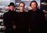 The Bee GEES Photo - 0297 Earls Courtlondon the Bee Gees  the Brit Awards 1997  -It Is Reported That Maurice Gibb Is Critically Ill After a Suspected Heart Attack- Mauricegibbretro