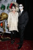 Bette Midler Photo - Debra Messing Arrives For Bette Midlers Hulaween Gala at the Waldorf Astoria in New York on October 28 2011 Photo by Sharon NeetlesGlobe Photos Inc
