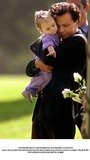 Bonnie Lee Bakley Photo - Actor Robert Blake hugs his 11-month-old daugther Rose Lenore Sophie Blake as she leans down to grab a white rose picked from the coffin bearing her slain mother Bonny Lee Bakley during a brief funeral ceremony in Los Angeles Friday May 25 2001  PHOTO SUPPLIED BY GLOBE PHOTOS INCAP POOL K21950NP