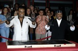 Ernie Isley Photo -  Hollywoods Rockwalk of Fame Inductions of the Isley Brothers Guitar Centerla CA 01112002 Ronald Isley and Ernie Isley Photo by Milan RybaGlobe Photosinc