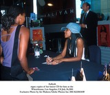Aaliyah Photo - Aaliyah Signs Copies of Her Latest Cd For Fans at the Wherehouse Los Angeles CA July 262001 Exclusive Photo by Art WaltersGlobe Photos Inc 2001