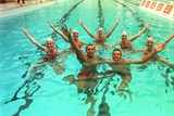 Ian Thorpe Photo - DAVE  MORGANALPHA 046933 28022002 SYDNEY AUSTRALIAGRANT HACKETT AND IAN THORPE SWIMMING WITH THE AUSSIE SYNCHRONISED SWIMMING TEAM AT NORTH SYDNEY POOL-OLYMPIC CHAMPIONS SWIMMERS IAN THORPE GRANT HACKET  KIEREN PERKINS DONNED NOSE PAGS AND JOINED MEMBERS OF THE AUSTRALIAN SYNCHRONSED SWIMMING SQUAD IN SYDNEY TO LAUNCH UNCLE TOBYS NEW EDGE FOR LIFE CAMPAIGNCREDIT DAVE MORGANALPHAGLOBE PHOTOS INC