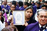 Cult Photo - 20041008 LIMA PERU The month of October is known for the celebration and cult of the Senor de los Milagros (Lord of Miracles) aka Cristo de Pachacamilla (Christ of Pachacamilla) During this month devotes follow the Lord  through the capital telling him about their hopes and desires for the future October is often referred as the month of faith since this is the time of year in which Peruans better demonstrate their sense of religion Las sahumadoras (the smokers) las cantoras (the singers) and los penitentes (the penitents)  follow the sacred image with devotion throughout the streets during this religious tradition PHOTO SYDNEY MOTTACITYFILES                             PHOTO BY SYDNEY MOTTACITYFILESGLOBE PHOTOSK39997