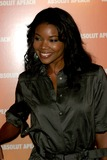 Gabrielle Union Photo - Desperate Housewife Nicollette Sheridan Rolls Out the Peach Carpet For New Flavor Absolut Apeach at Koi at the Bryant Park Hotel New York City 05-16-2005 Photo John Zissel-ipol-Globe Photos Inc 2005 Gabrielle Union