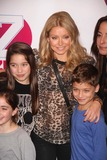 Kelly Ripa Photo - Kelly Ripa and Her 2 Kids in Pressroom at Z100s Jingle Ball Concert at Madison Square Garden 12-7-2012 Photo by John BarrettGlobe Photos