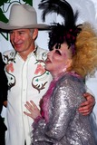 Bette Midler Photo - Bette Midler and John Mcenroe Arrive For the Hulaween Gala at the Waldorf Astoria in New York on October 30 2009 Photo by Sharon NeetlesGlobe Photos Inc