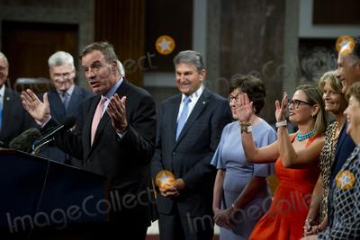 Photo - United States Senator Mark Warner (Democrat of Virginia) makes remarks after the vote on the motion to invoke cloture to proceed to the consideration of HR 3684 the INVEST in America Act on Capitol Hill in Washington DC on Wednesday July 28 2021 The vote to begin discussion of the bipartisan infrastructure bill agreed to by the White House was 67 to 32 If passed the bill would invest close to 1 trillion in roads bridges ports and other infrastructure without a major tax increaseCredit Rod Lamkey  CNPAdMedia