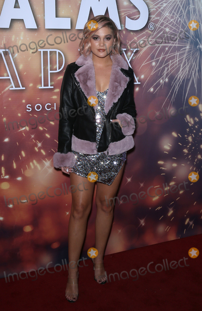 Photos From Olivia Holt spends NYE at Apex Social Club