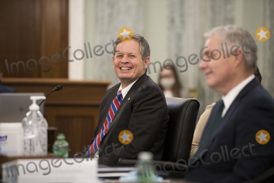 Photo - United States Senator Steve Daines (Republican of Montana) left is joined by Amtrak President and Chief Executive Officer William Flynn right during the first panel of a Senate Committee on Commerce Science and Transportation hearing to examine passenger and freight rail focusing on the current status of the rail network and the track ahead in the Russell Senate Office Building on Capitol Hill in Washington DC Wednesday October 21 2020 Credit Rod Lamkey  CNPAdMedia