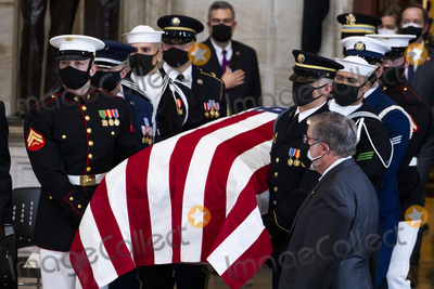 Photo - UNITED STATES - APRIL 13 The casket of US Capitol Officer William Billy Evans arrives for his remains to lie in honor in the Capitol Rotunda in Washington DC on Tuesday April 13 2021 Evans was killed when a driver rammed the north barricade of the Capitol on April 2 2021Credit Tom Williams  Pool via CNPAdMedia