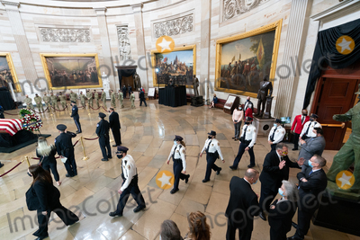 Photo - Members of US Capitol Police pay their respects to the body of their colleague US Capitol Police officer William Evans in the Rotunda of the US Capitol in Washington DC on Tuesday April 13 2021 Credit Amr Alfiky  Pool via CNPAdMedia