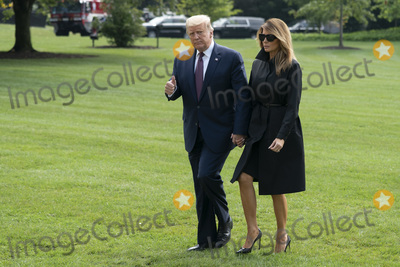 Photo - President Trump Presents  and First Lady Melania Trump Return to the White House
