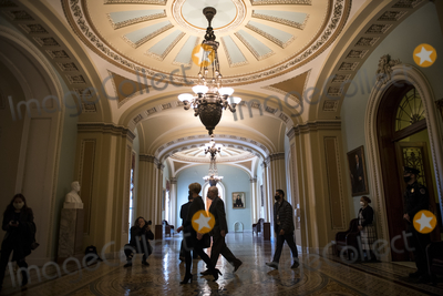 Photo - United States Senate Majority Leader Mitch McConnell (Republican of Kentucky) makes his way back to his office from the Senate chamber at the US Capitol