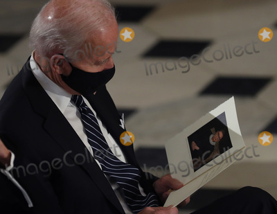 Photo - Democratic Presidential Candidate Joe Biden attends a ceremony where US Supreme Court Associate Justice Ruth Bader Ginsburgs flag-draped casket will lie in state at the US Capitol on September 25 2020 in Washington DC Ginsburg who was appointed by former US President Bill Clinton served on the high court from 1993 until her death on September 18 2020 She is the first woman to lie in state at the Capitol Credit Chip Somodevilla  Pool via CNPAdMedia