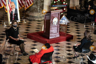 Nancy Pelosi Photo - Speaker of the United States House of Representatives Nancy Pelosi (Democrat of California) attends a ceremony celebrating the life of the late former US Representative Alcee Hastings (Democrat of Florida) in Statuary Hall of the Capitol in Washington DC on April 21st 2021Credit Anna Moneymaker  Pool via CNPAdMedia
