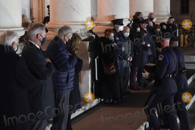 American Flag Photo - An honor guard carries an urn with the cremated remains of US Capitol Police officer Brian Sicknick and a folded American flag up the steps of the US Capitol to lie in honor in the Rotunda Tuesday Feb 2 2021 in WashingtonCredit Alex Brandon  Pool via CNPAdMediaAdMedia