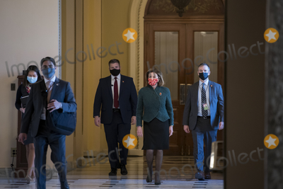 Photos From Speaker of the United States House of Representatives Nancy Pelosi (Democrat of California) arrives at the U.S. Capitol for a veto override vote of the NDAA.