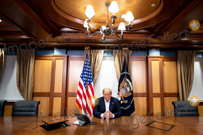 Photo - Trump Poses for a Photo as he Participates in a Phone Call