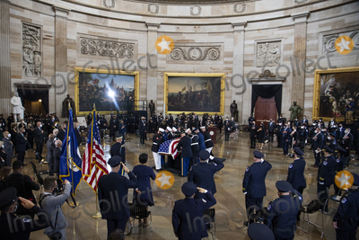 Photo - UNITED STATES - APRIL 13 An honor guard places the remains of US Capitol Police Officer William Billy Evans on the Lincoln catafalque to lie in honor in the Capitol Rotunda in Washington DC on Tuesday April 13 2021 Evans was killed when a driver rammed the north barricade of the Capitol on April 2 2021 Credit Tom Williams  Pool via CNPAdMedia