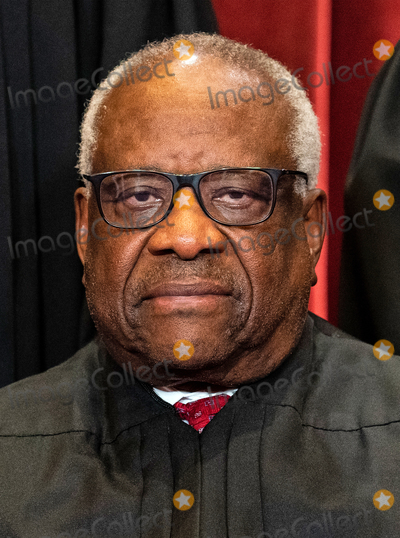 CLARENCE THOMAS Photo - Associate Justice of the Supreme Court Clarence Thomas sits during a group photo of the Justices at the Supreme Court in Washington DC on April 23 2021 Credit Erin Schaff  Pool via CNPAdMedia