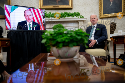 Photos From U.S. President Biden participates in a virtual bilateral meeting with Ireland's Prime Minister Martin in the Oval Office at the White House in Washington