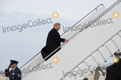 Photo - United States President Donald J Trump boards Air Force One after speaking to members of the media at Joint Base Andrews as he departs Washington DC US for Los Angeles California on Tuesday February 18 2020Credit Stefani Reynolds  CNPAdMedia