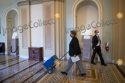 Photos From The package of legislation for the National Defense Authorization Act (NDAA) and the House bill for $2,000.00 stimulus checks arrives at the Senate Chamber.