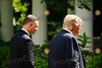 Photo - US President Donald J Trump and Polish President Andrzej Duda (L) depart after holding a joint press conference in the Rose Garden of the White House in Washington DC USA 24 June 2020 Duda a conservative nationalist facing a tight re-election race back home is the first foreign leader to visit the White House in more than three monthsCredit Jim LoScalzo  Pool via CNPAdMedia