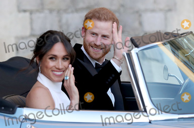 Photo - 19 May 2018 - The newly married Duke and Duchess of Sussex Meghan Markle and Prince Harry leaving Windsor Castle after their wedding to attend an evening reception at Frogmore House hosted by the Prince of Wales Photo Credit ALPRAdMedia