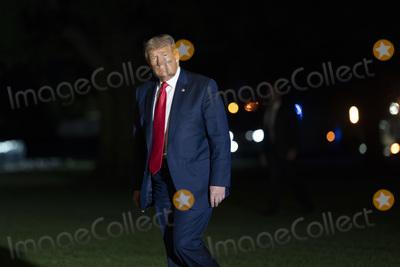 Photo - President Donald Trump Returns to the White House
