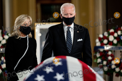 Photo - Former United States Vice President Joe Biden the Democratic Party candidate for President right and his wife Dr Jill Biden left attend a ceremony where Justice Ruth Bader Ginsburg lies in state in Statuary Hall of the Capitol in Washington DC on September 25 2020 Credit Erin Schaff  Pool via CNPAdMedia